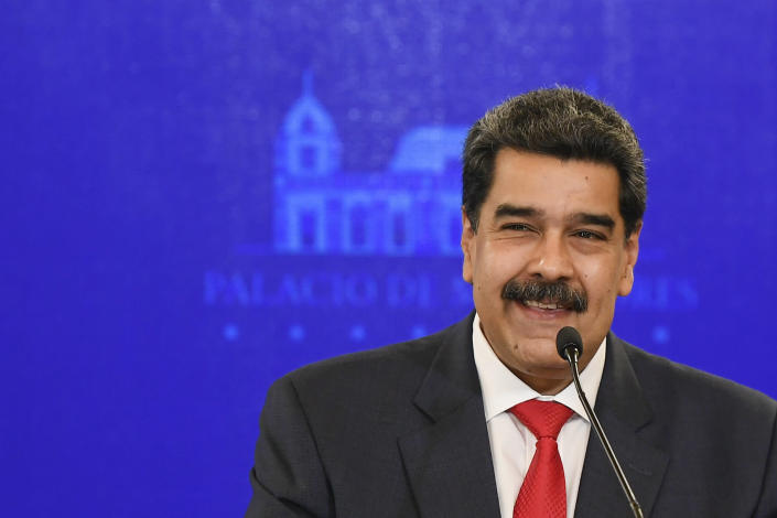Venezuela's President Nicolas Maduro smiles during a press conference at Miraflores Presidential Palace in Caracas, Venezuela, Tuesday, Dec 8, 2020. Maduro has cemented formal control over all major institutions of power in Venezuela with authorities reporting Monday that his political alliance easily won a majority in congress with 31% of Venezuelans eligible voters voting Sunday. (AP Photo/Matias Delacroix)