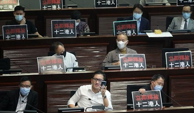 Pan-democrats display protest signs during a meeting of Legco's Finance Committee in September. Photo: Sam Tsang