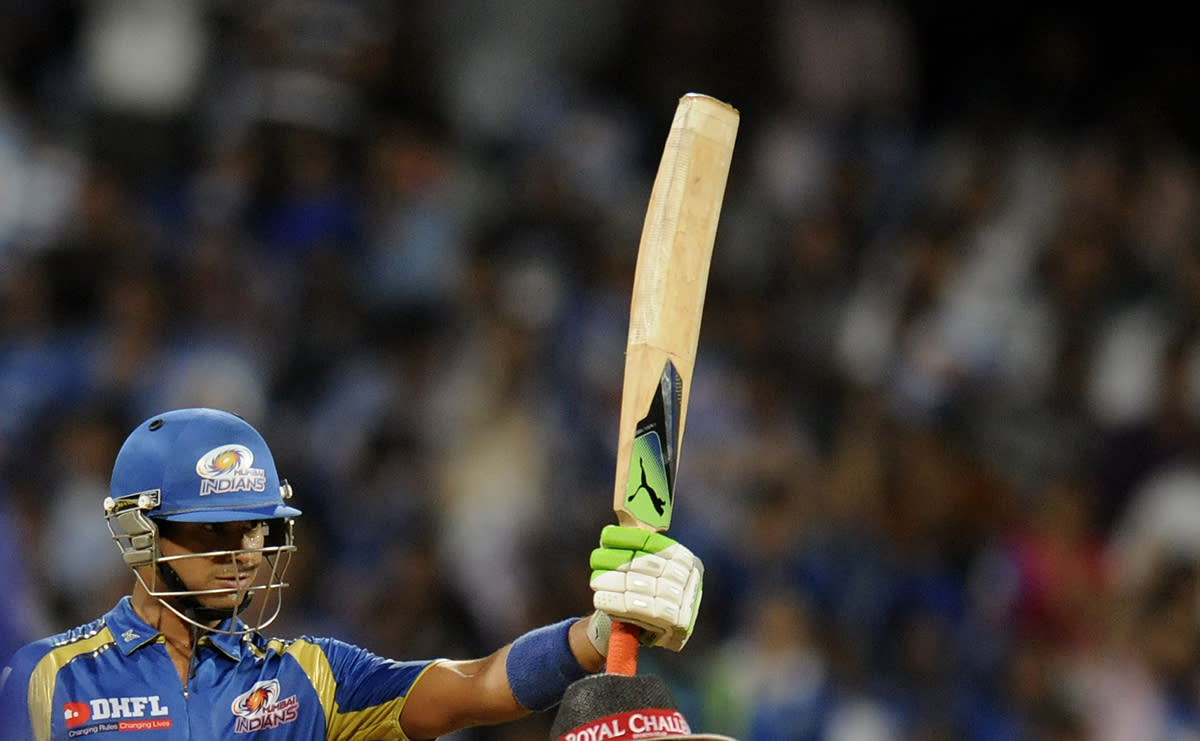 Aditya Tare of Mumbai Indians raises his bat after scoring a half century during match 66 of the Pepsi Indian Premier League ( IPL) 2013  between The Mumbai Indians and the Rajasthan Royals held at the Wankhede Stadium in Mumbai on the 15th May 2013 ..Photo by Pal Pillai-IPL-SPORTZPICS ..Use of this image is subject to the terms and conditions as outlined by the BCCI. These terms can be found by following this link:..https://ec.yimg.com/ec?url=http%3a%2f%2fwww.sportzpics.co.za%2fimage%2fI0000SoRagM2cIEc&t=1506275268&sig=k5CR8L8QNMCaonk9PmH8hQ--~D