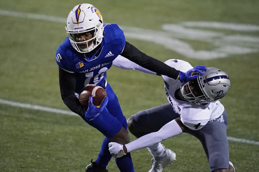 FILE - In this Friday, Dec. 11, 2020 file photo, Nevada defensive back EJ Muhammad (4) tackles San Jose State wide receiver Tre Walker (10) during the second half of an NCAA college football game in Las Vegas. No. 25 San Jose State will face perennial conference powerhouse Boise State in the Mountain West championship on Saturday, Dec. 19, 2020 in Las Vegas. The game is usually played on the higher seeds home field but this year it will be held at Sam Boyd Stadium. (AP Photo/John Locher, File)
