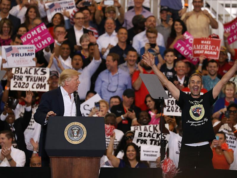 Blacks for Trump supporters waving placards behind Donald Trump during a rally in Florida last weekend: Joe Raedle/Getty Images