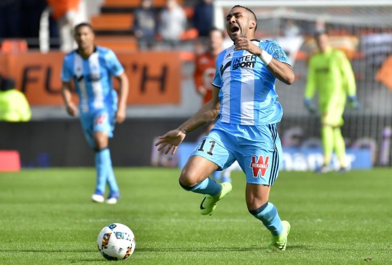 Marseille's French forward Dimitri Payet runs with the ball during the French L1 football match between Lorient and Marseille at the Moustoir stadium in Lorient, western France, on March 5, 2017