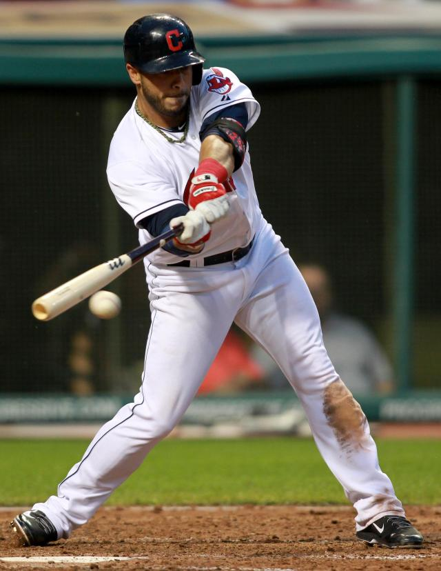 Cleveland Indians' Mike Aviles hits an RBI single in the fourth inning of a baseball game against the Texas Rangers on Friday, Aug. 1, 2014, in Cleveland. (AP Photo/Aaron Josefczyk)