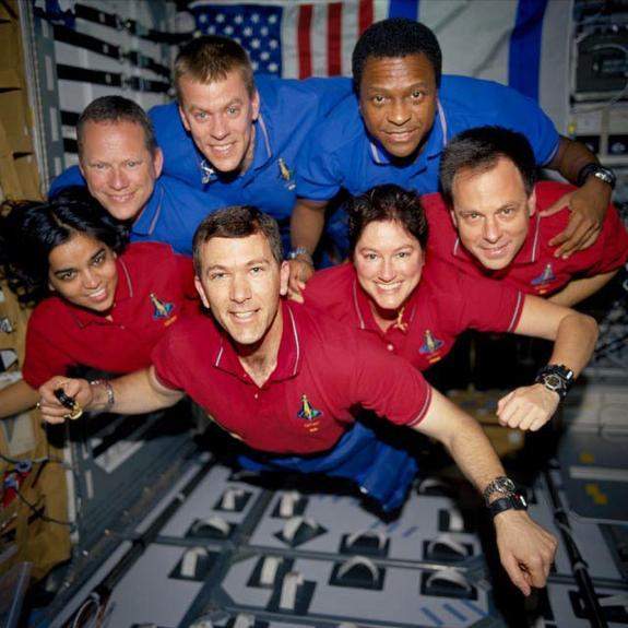 This image of the STS-107 crew in orbit was recovered from wreckage inside an undeveloped film canister. The shirt color's indicate their mission shifts. From left (bottom row): Kalpana Chawla, mission specialist; Rick Husband, commander; Laure