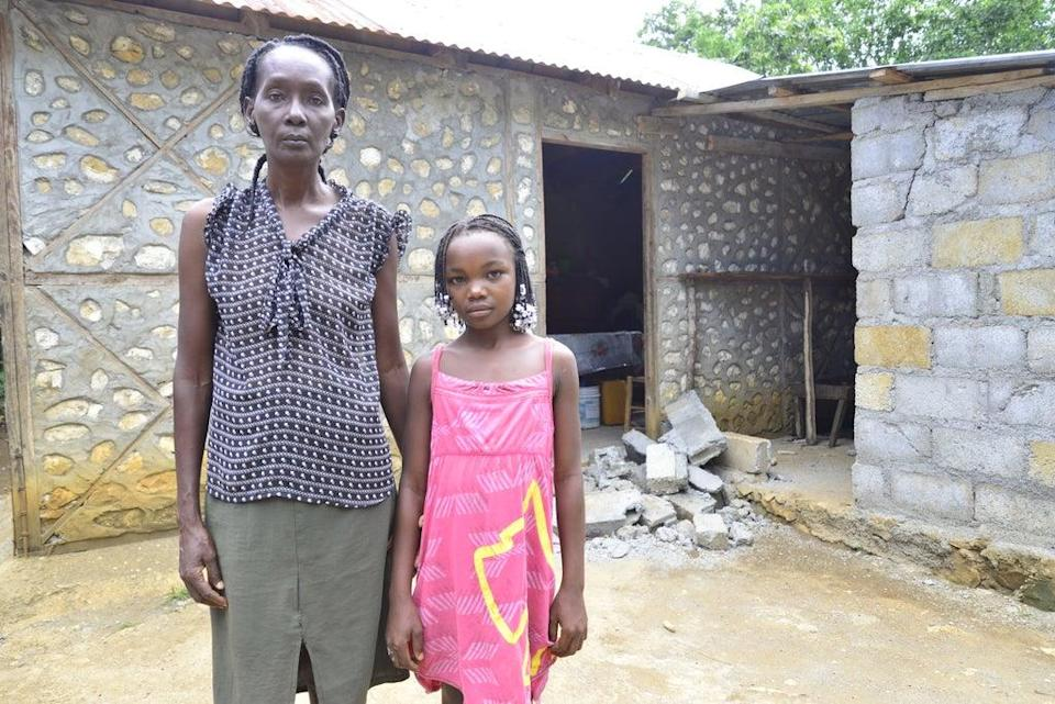 Paulène and her daughter Natalie, in front of their house destroyed by the earthquake (ActionAid)