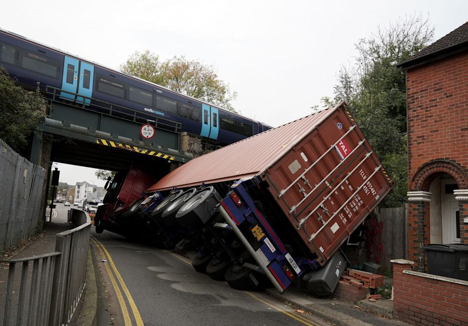 An articulated lorry which hit a bridge in Coombe Valley Road, Dover, this morning. The lorry was left on its side after the collision.