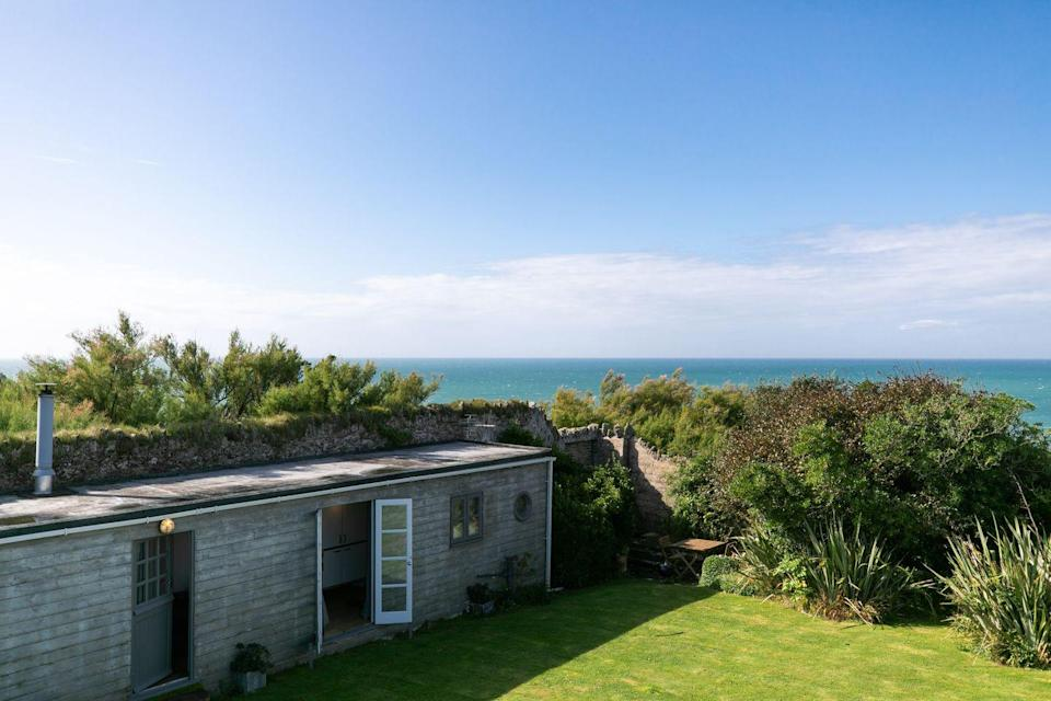 """<p>This is a very special seaside hideaway, complete with a wood burner, a pretty huge bathtub, a mini kitchen and views across the bay. </p><p>With French doors that open onto the lawn overlooking a cove below, squint hard enough and you'll be able to see St Michaels' Mount. Better yet, tea and fresh coffee, organic milk and homemade biscuits or cake will be handed to you on arrival, with the option of wine or champagne if you let the hosts know in advance. </p><p>This coastal spot is located a 20 minute-drive from Lizard Point (we advise heading there to watch the seals and visit the lighthouse) and St Michael's Mount, as well as a short distance from St Ives, Porthleven and Penzance. </p><p><strong>Cabin for 2 from £84 per night</strong></p><p><a class=""""link rapid-noclick-resp"""" href=""""https://www.canopyandstars.co.uk/britain/england/cornwall/halzephron-house/halzephron-cabin#search_type=keyword&search_text=cornwall&"""" rel=""""nofollow noopener"""" target=""""_blank"""" data-ylk=""""slk:BOOK ONLINE"""">BOOK ONLINE </a></p>"""