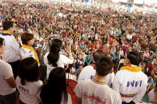 Thousands of Thais loyal to ex-premier Thaksin Shinawatra gather for a political rally in rural Chaiyaphum