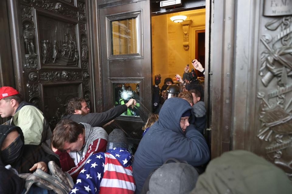 Protesters attempt to enter the US Capitol Building in Washington DC.