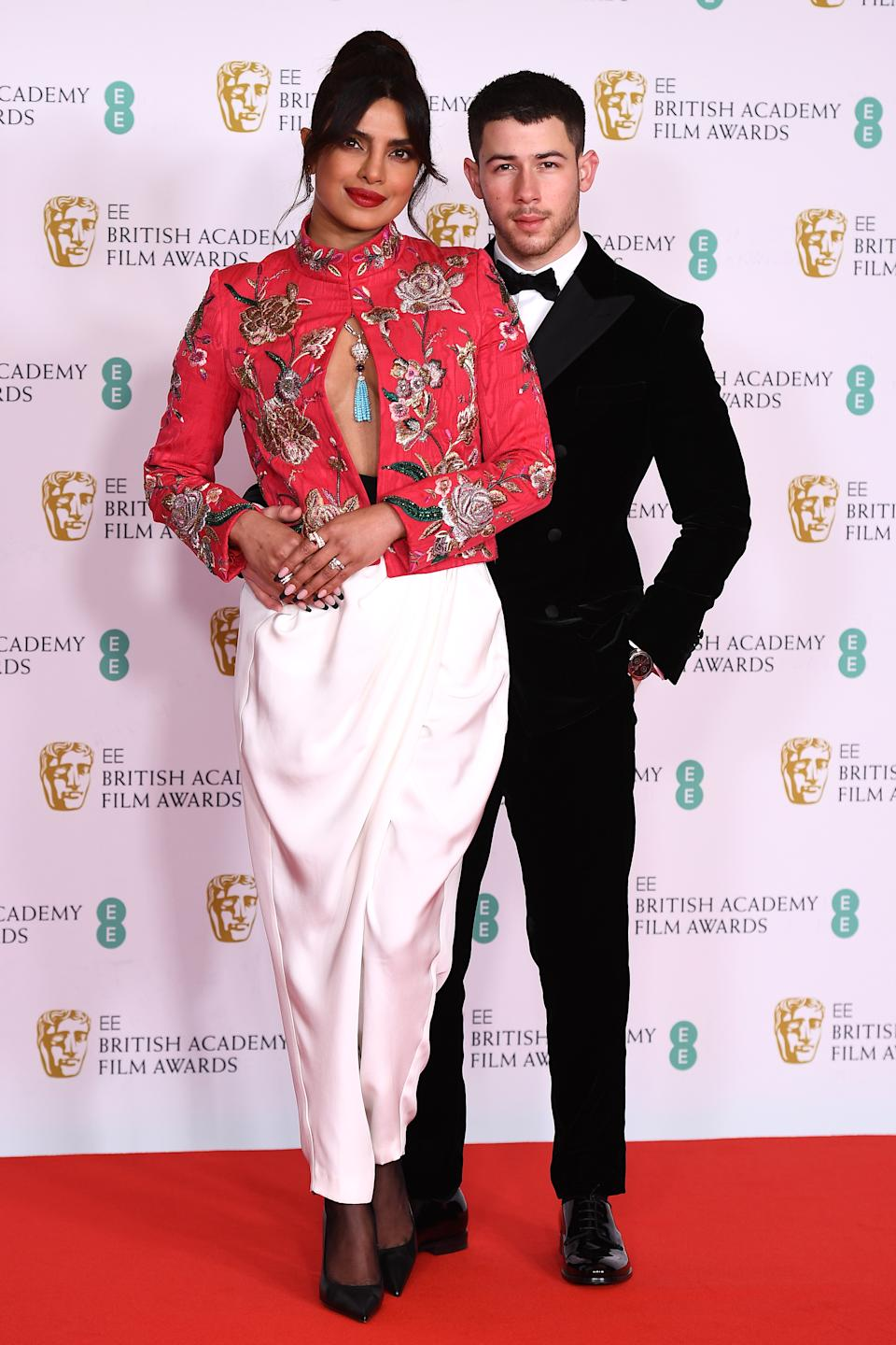 LONDON, ENGLAND - APRIL 11: Awards Presenter Priyanka Chopra Jonas with her husband Nick Jonas attend the EE British Academy Film Awards 2021 at the Royal Albert Hall on April 11, 2021 in London, England. (Photo by Jeff Spicer/Getty Images)