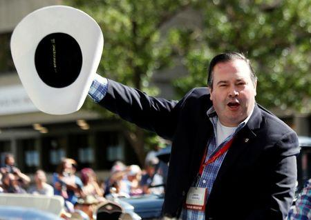FILE PHOTO - Jason Kenney who announced he will be seeking the leadership of the Alberta PC party waves his hat during the Calgary Stampede parade in Calgary, Alberta, Canada July 8, 2016. REUTERS/Todd Korol