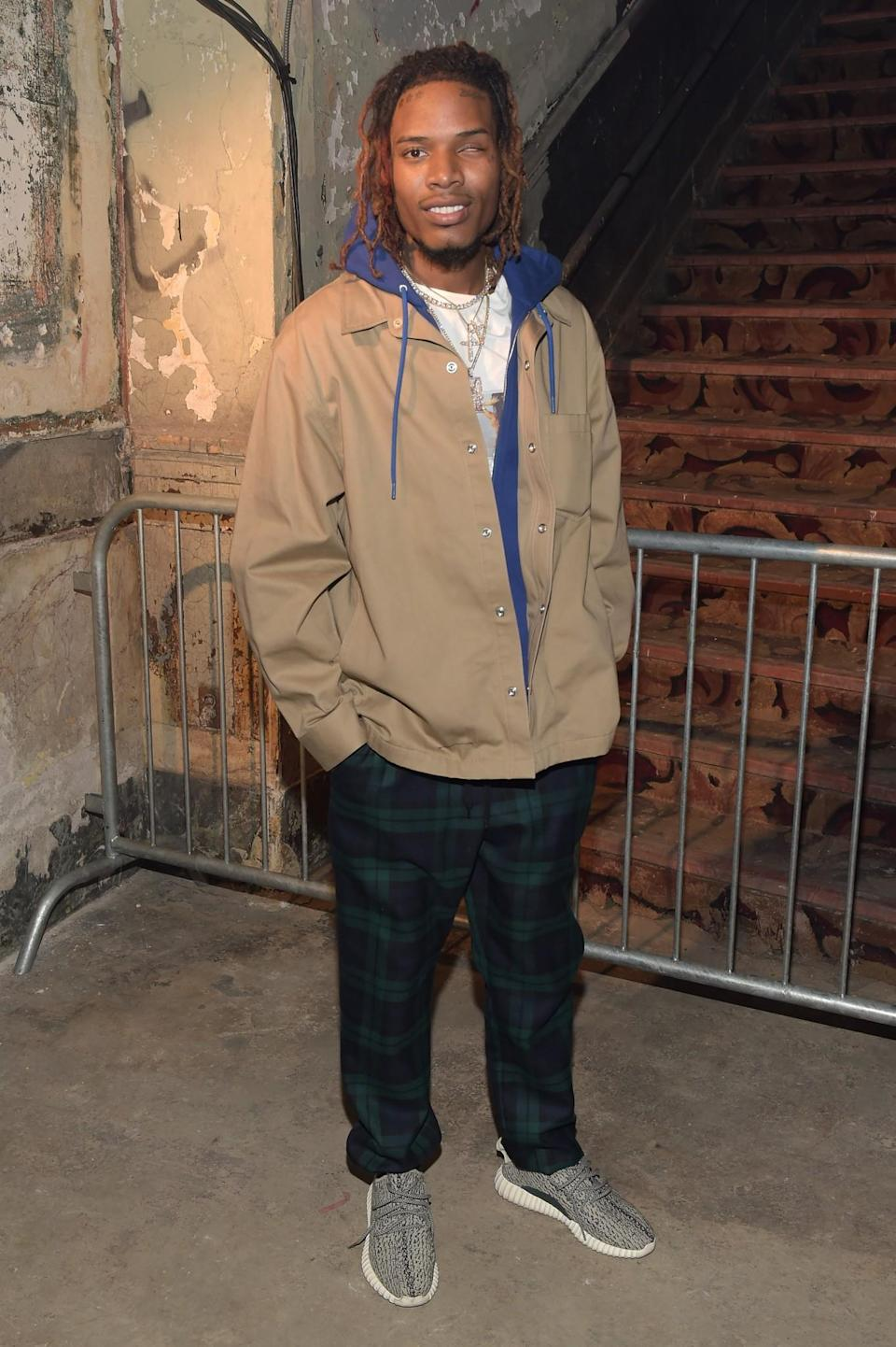 <p>Fetty Wap was also casual in Yeezys and checked trousers. <i>[Photo: Getty]</i> </p>