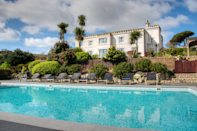 """<p>Up to 26 of you can stay in Polpier, a Mevagissy mansion with views of the palm trees and harbour below, heated swimming pool, tennis court, games room with pool table and even its own mini club - yes, you read that right, this amazing house has a room with a DJ booth and disco lights. </p><p>Two-night, midweek break from £2450, that's £153pp based on 16 people sharing.</p><p><a class=""""link rapid-noclick-resp"""" href=""""https://www.polpier.co.uk/polpier/"""" rel=""""nofollow noopener"""" target=""""_blank"""" data-ylk=""""slk:BOOK HERE"""">BOOK HERE</a></p>"""
