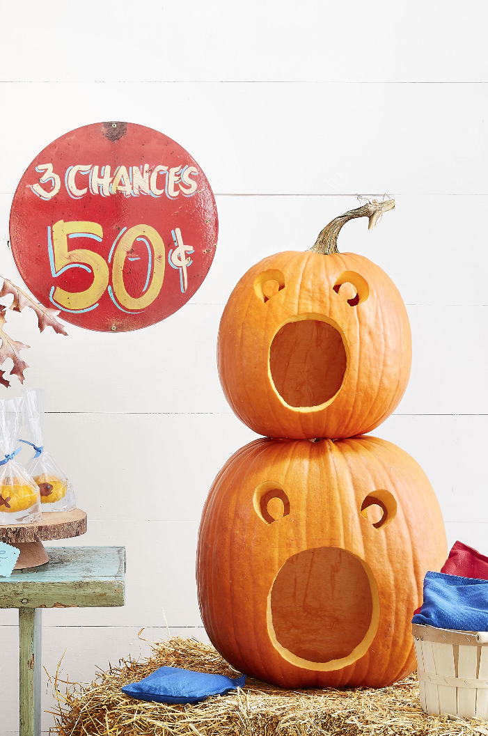 <p>No, these pumpkins aren't screaming, they're just getting ready to join in on the Halloween festivities. Stack two on top of each other, give them a big enough mouth, and you've got the perfect bean bag toss game. <br></p>