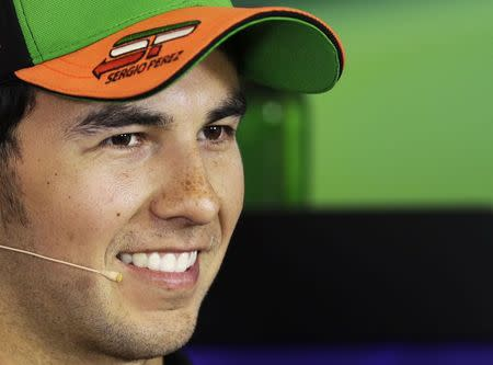 Force India Formula One driver Sergio Perez of Mexico smiles during a news conference at the Hungaroring circuit, near Budapest July 24, 2014. REUTERS/David W Cerny