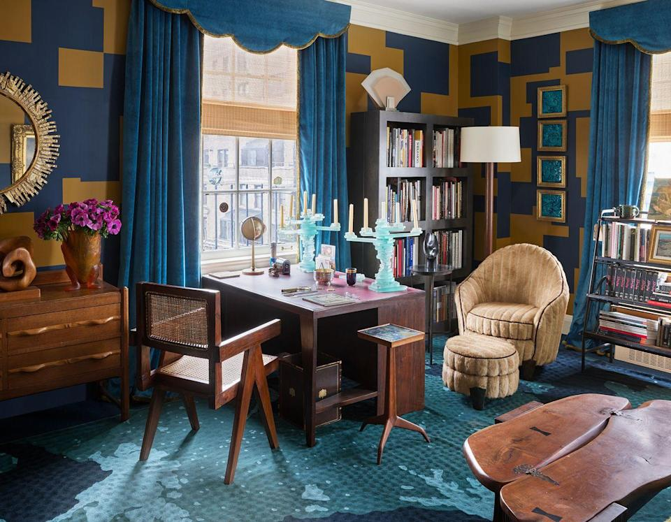 """<p>Nothing kills a good mood like staring at a blank wall all. day. long. If you can, cozy your desk up to a window—even a small one—then incorporate decor that speaks to your style. (If that's not an option, we have another natural light hack ahead!) Here, <a href=""""https://www.housebeautiful.com/design-inspiration/house-tours/a33538067/ann-pyne-mcmillen-apartment/"""" rel=""""nofollow noopener"""" target=""""_blank"""" data-ylk=""""slk:Ann Pyne"""" class=""""link rapid-noclick-resp"""">Ann Pyne</a> worked with decorative painter Arthur Fowler to create the geometric pattern on the walls. """"I think of the puzzle-like shapes as a metaphor—it's a game of fitting all these disparate 'treasures' into a graphically coherent whole,"""" she says. </p>"""