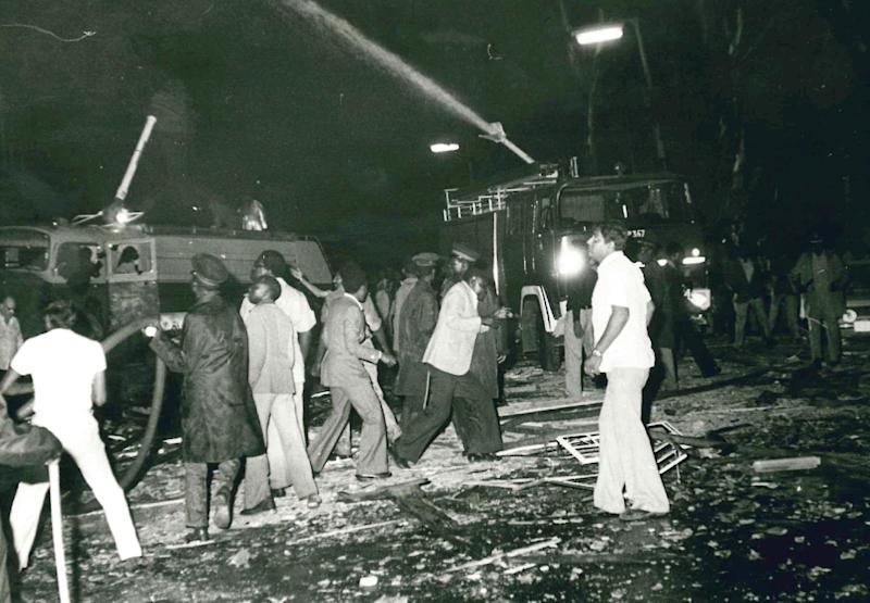 In this photo taken Jan. 1, 1981 rescuers and firemen attend to the scene of a bombing in which 20 died at the Norfolk Hotel in Nairobi, Kenya. The attack on the Norfolk Hotel, popular among foreign tourists, preceded the Sept. 21, 2013 assault on the Westgate Mall in Nairobi by a generation but then as now, a city landmark was hit, Kenyan and foreign civilians died, leaders pledged to stop it happening again and talk turned to recovery. (AP Photo)