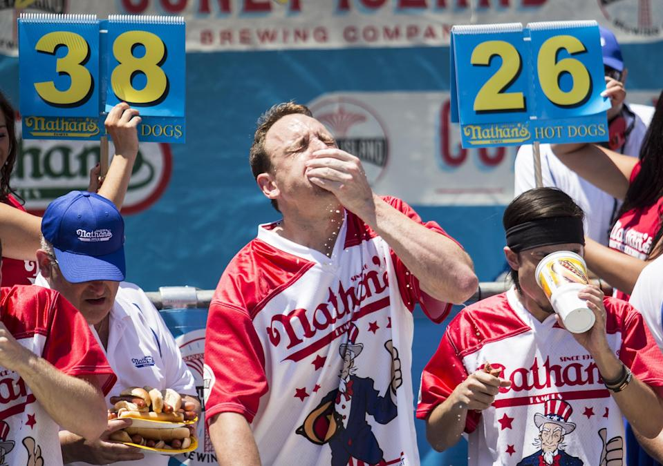 NEW YORK, NY – JULY 04: Joey Chestnut won his third straight Nathan's Famous Hot Dog Eating Contest, but it wasn't without drama. (Photo by Alex Wroblewski/Getty Images)