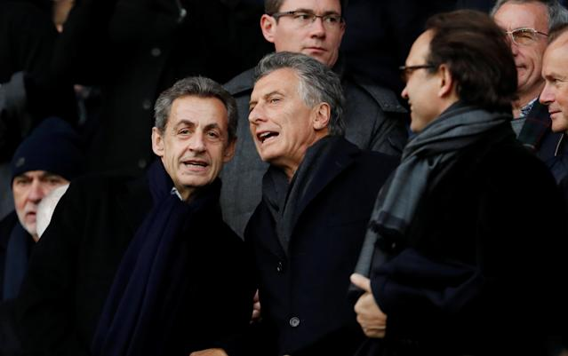 Soccer Football - Ligue 1 - Paris St Germain vs Montpellier - Parc des Princes, Paris, France - January 27, 2018 Former President of France Nicolas Sarkozy with President of Argentina Mauricio Macri in the stands before the match REUTERS/Gonzalo Fuentes