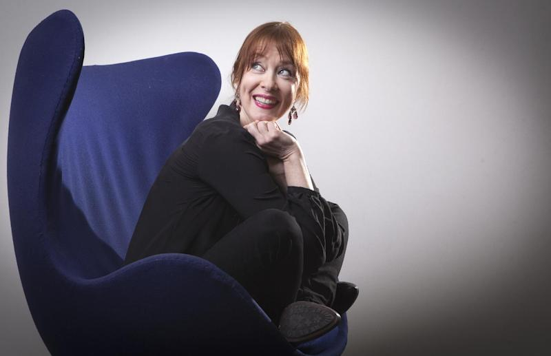 """This March 7, 2014 photo shows Suzanne Vega in New York. Vega's latest release is """"Tales From the Realm of the Queen of Pentacles."""" (Photo by Carlo Allegri/Invision/AP)"""