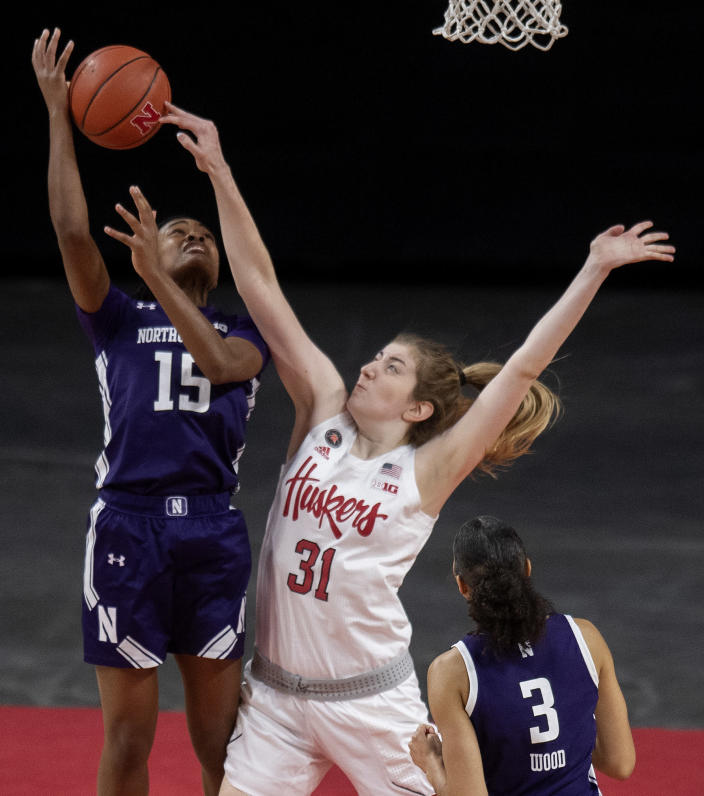 Northwestern's Courtney Shaw (15) is fouled by Nebraska's Kate Cain (31) in the first half of an NCAA college basketball game as Northwestern's Sydney Wood (3) looks on Thursday, Dec. 31, 2020, in Lincoln, Neb. (Francis Gardler/Lincoln Journal Star via AP)
