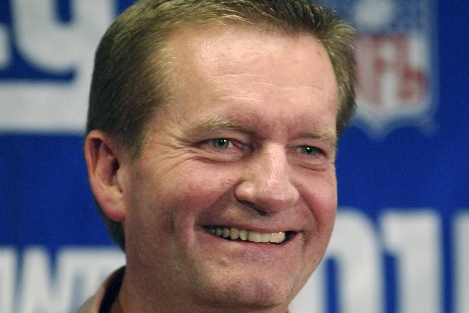 FILE - New York Giants coach Jim Fassel smiles as he talks to reporters at Giants Stadium in East Rutherford, N.J., in this Monday, Dec. 30, 2002, file photo. Fassel, a former coach of the New York Giants who was named NFL coach of the year in 1997 and led the team to the 2001 Super Bowl, has died. He was 71. Fassel's son, John, confirmed the death to the Los Angeles Times on Monday, June 7, 2021. According to the Los Angeles Times, Fassel was taken to a hospital in Las Vegas with chest pains and died of a heart attack. (AP Photo/Bill Kostroun, File)