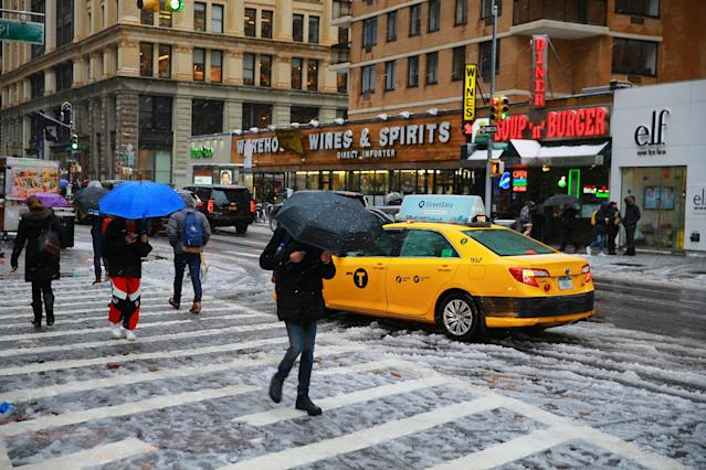 <p>Pedestrians walk along Broadway during snowstorm in New York City on March 7, 2018. (Photo: Gordon Donovan/Yahoo News) </p>