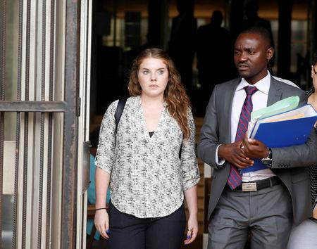 U.S. citizen Martha O'Donovan (L) accused of attempting to subvert former President Robert Mugabe's government leaves the courts in Harare, Zimbabwe, December 8, 2017.REUTERS/Philimon Bulawayo