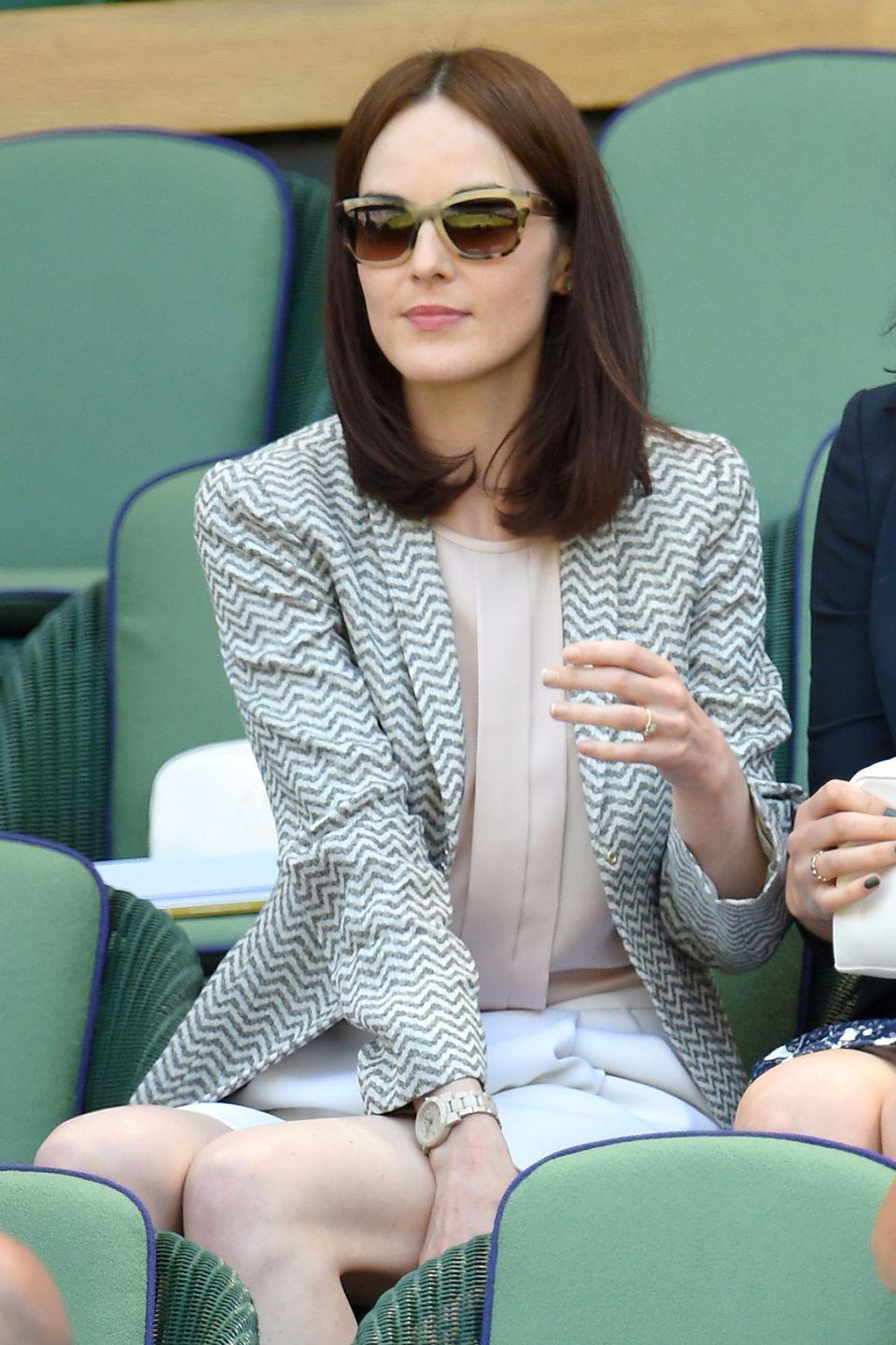 <p><strong>2015</strong> Michelle Dockery teamed white tailored shorts with a blouse and a printed blazer.</p>