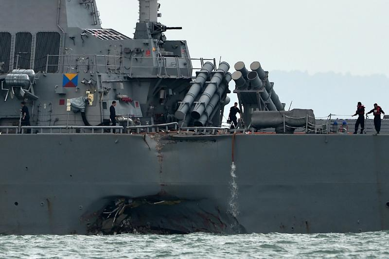A collision between USS John S. McCain and an oil tanker off Singapore left a huge gash in the side of the guided-missile destroyer (AFP Photo/Roslan RAHMAN)