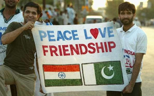 KARACHI, PAKISTAN - MARCH 13 : Cricket fans hold a sign which says 'Peace Love Friendship' after the first Pakistan v India one day international match played at the National Stadium March 13, 2004 in Karachi, Pakistan. It is the Indian teams first full tour of Pakistan in almost 15 years, comprising five one-day internationals followed by three Tests. The tour is seen as evidence that the two nuclear-armed rivals are getting closer after almost going to war over the Himalayan region of Kashmir less than two years ago. (Photo by Scott Barbour/Getty Images) *** Local Caption ***
