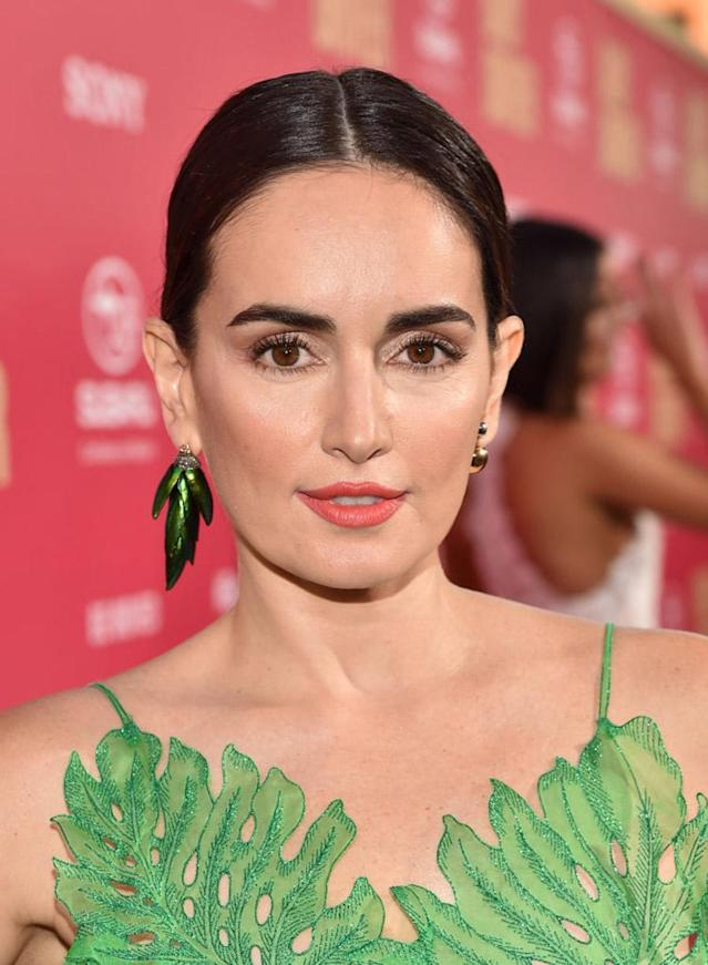 <p>De la Reguera posed on the red carpet at the Los Angeles premiere for <em>Baby Driver</em> sporting a center-parted updo, bold brows, dewy skin, and matte peach lipstick. (Photo: Alberto E. Rodriguez/Getty Images) </p>
