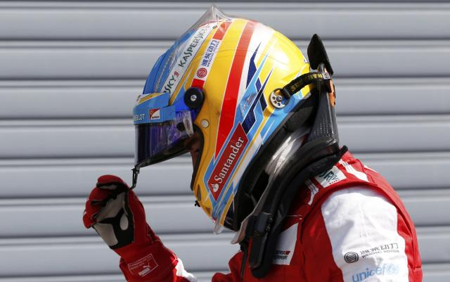 Ferrari Formula One driver Fernando Alonso of Spain is pictured after the qualifying session of the Italian F1 Grand Prix at the Monza circuit September 7, 2013. Alonso qualified fifth. REUTERS/Stefano Rellandini (ITALY - Tags: SPORT MOTORSPORT F1)