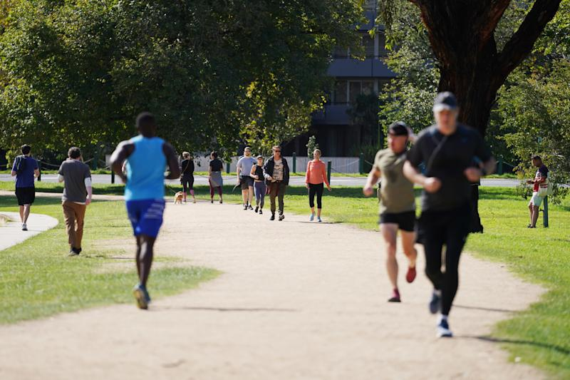 People exercise at Albert Park Lake in Melbourne. Source: AAP