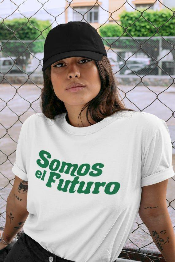 """<p><strong>Mundo Latinx</strong></p><p>etsy.com</p><p><strong>$26.99</strong></p><p><a href=""""https://go.redirectingat.com?id=74968X1596630&url=https%3A%2F%2Fwww.etsy.com%2Flisting%2F893030832%2Fsomos-el-futuro-shirt-we-are-the-future&sref=https%3A%2F%2Fwww.goodhousekeeping.com%2Flife%2Fg37261440%2Flatinx-owned-etsy-shops%2F"""" rel=""""nofollow noopener"""" target=""""_blank"""" data-ylk=""""slk:Shop Now"""" class=""""link rapid-noclick-resp"""">Shop Now</a></p><p>Mundo Latinx is a shop selling """"apparel championing the Latinx community."""" Millions of Latinos now call the U.S. home and are declaring that <em>somos el future</em> (""""we are the future"""" in English). <strong>The inclusive message is printed on a soft cotton T-shirt,</strong> and it's almost a guarantee your Spanish-speaking peers will want one of their own to help spread the word.</p>"""