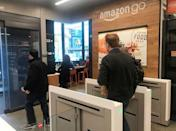 A customer walks out of the Amazon Go store, without needing to pay at a cash register due to cameras, sensors and other technology that track goods that shoppers remove from shelves and bill them automatically after they leave, in Seattle, Washington, U.S., January 18, 2018. Photo taken January 18, 2018. REUTERS/Jeffrey Dastin