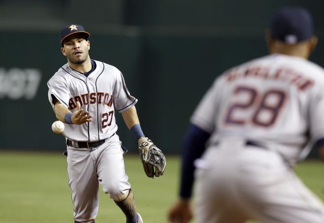 Houston Astros' Jose Altuve (27) flips the ball to Jon Singleton (28) to get Arizona Diamondbacks' Ender Inciarte out at first base during the third inning of a baseball game on Monday, June 9, 2014, in Phoenix. (AP Photo/Ross D. Franklin)