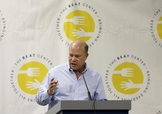 FILE - In this May 10, 2016, file photo, billionaire hedge fund manager David Tepper, addresses a gathering during a grand opening of rock star and philanthropist Jon Bon Jovi's Jon Bon Jovi Soul Foundation Soul Kitchen and B.E.A.T. Center, which stands for Bringing Everyone All Together, in Toms River, N.J. People familiar with the situation say Tepper has agreed to buy the Carolina Panthers from team founder Jerry Richardson for a record $2.2 billion. The people spoke to The Associated Press on Tuesday, May 15, 2018, on condition of anonymity because the team has not yet announced the sale. The purchase is subject to a vote at the NFL owners meeting next week in Atlanta. (AP Photo/Mel Evans, File)