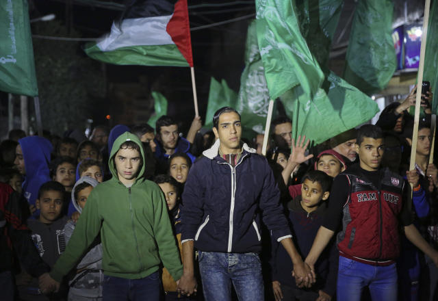 <p>Hamas supporters wave their green flags during a protest against the possible U.S. decision to recognize Jerusalem as Israel's capital, in Jebaliya Refugee Camp, Gaza Strip, Wednesday, Dec. 6, 2017. (Photo: Adel Hana/AP) </p>