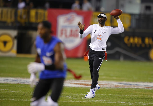Michael Vick throws one more pass. (AP)