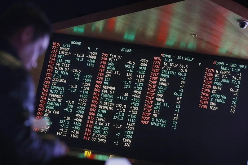 FILE - In this Jan. 14, 2015, file photo, odds are displayed on a screen at a sports book owned and operated by CG Technology in Las Vegas. Las Vegas casinos can't agree on an NCAA tournament favorite, with favorites changing within hours. (AP Photo/John Locher, File)
