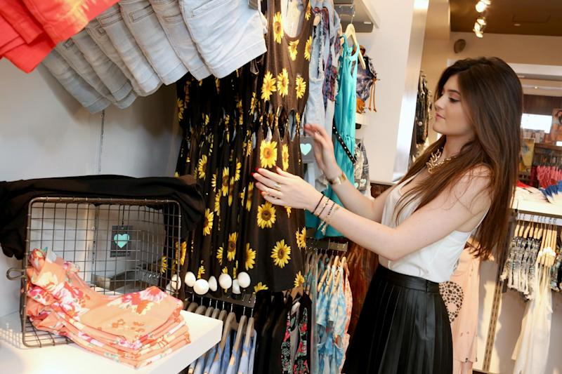 IMAGE DISTRIBUTED FOR PACSUN - Kylie Jenner shops the exclusive Kendall & Kylie summer collection at PacSun in Santa Monica, Calif. on Friday, May 10, 2013. (Photo by Casey Rodgers/Invision for PacSun/AP Images)