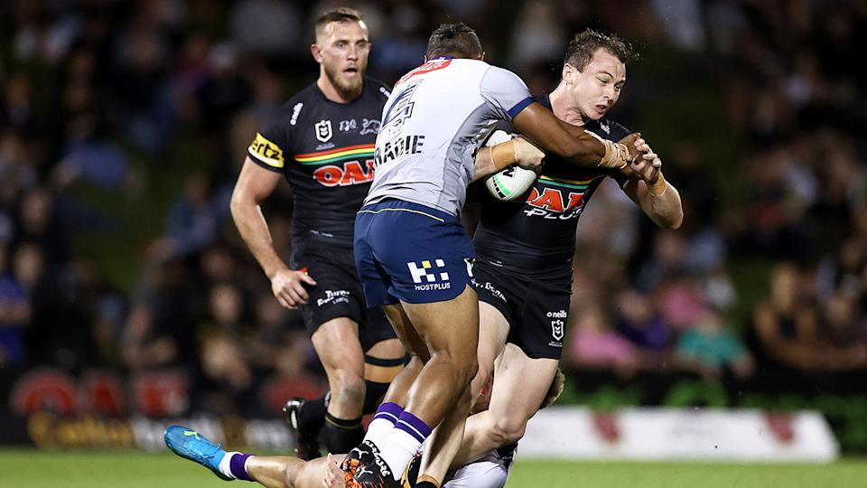 Seen here, Panthers fullback Dylan Edwards gets tackled against the Storm on Thursday night.