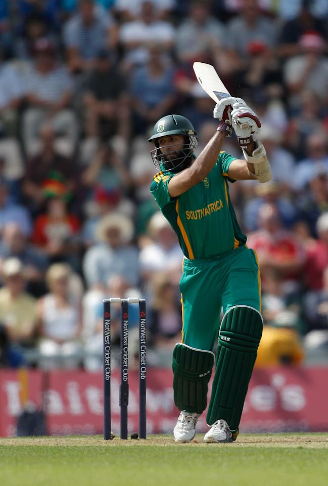 SOUTHAMPTON, ENGLAND - AUGUST 28:  Hashim Amla of South Africa hits out during the 2nd NatWest Series ODI match between England and South Africa at the Ageas Bowl on August 28, 2012 in Southampton, England.  (Photo by Harry Engels/Getty Images)