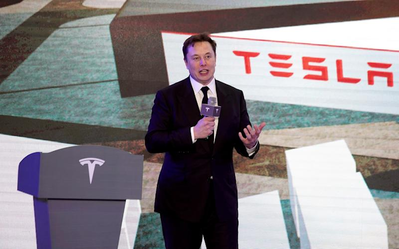Tesla Inc CEO Elon Musk speaks at an opening ceremony for Tesla China-made Model Y program in Shanghai - Aly Song/REUTERS
