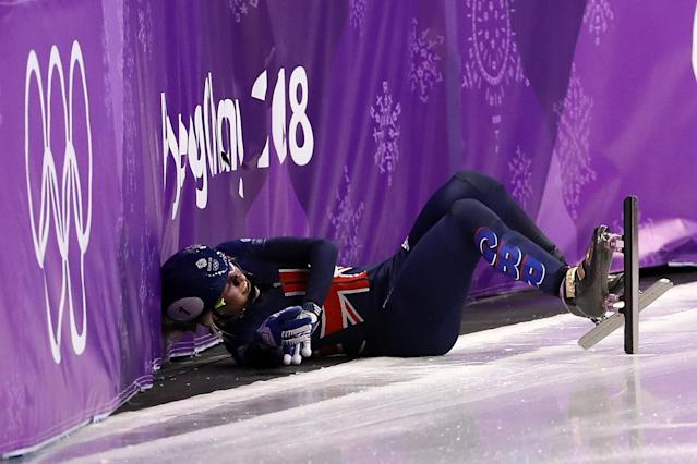 Elise Christie of Great Britain falls after a crash with Jinyu Li of China during the Short Track Speed Skating Ladies' 1500m Semifinals on day eight of the PyeongChang 2018 Winter Olympic Games at Gangneung Ice Arena on February 17, 2018 in Gangneung, South Korea. (Photo by Jamie Squire/Getty Images)