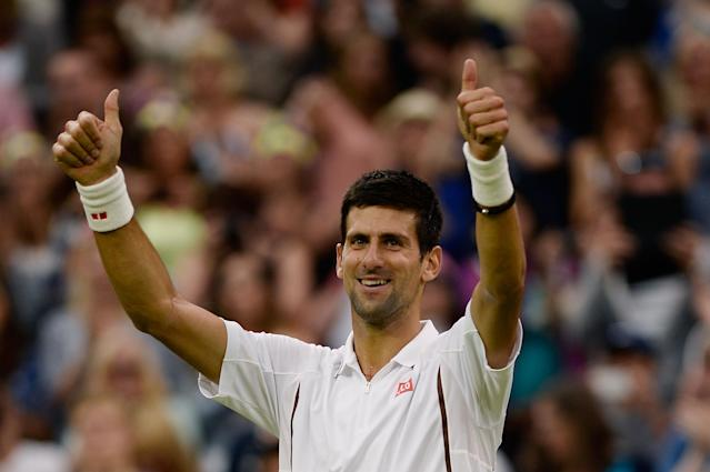 LONDON, ENGLAND - JUNE 27: Novak Djokovic of Serbia celebrates match point during his Gentlemen's Singles second round match against Bobby Reynolds of the United States of America on day four of the Wimbledon Lawn Tennis Championships at the All England Lawn Tennis and Croquet Club on June 27, 2013 in London, England. (Photo by Dennis Grombkowski/Getty Images)
