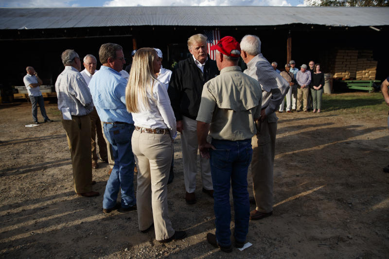 President Donald Trump meets with farmers impacted by Hurricane Michael, Monday, Oct. 15, 2018, in Macon, Ga. (AP Photo/Evan Vucci)