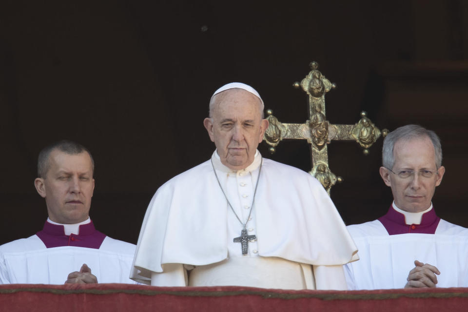 Pope Francis looks at the crowd after he delivered the Urbi et Orbi (Latin for 'to the city and to the world' ) Christmas' day blessing from the main balcony of St. Peter's Basilica at the Vatican, Wednesday, Dec. 25, 2019. (AP Photo/Alessandra Tarantino)