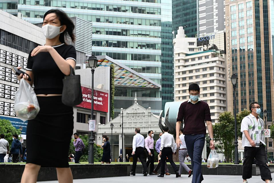 People seen in the financial business district of Raffles Place on 11 January. (PHOTO: Getty Images)
